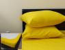 Комплект простирадла на резинці з наволочками (180*200*25) жовтий